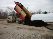 8 cubic yards dumped out of Ski Landscape truck